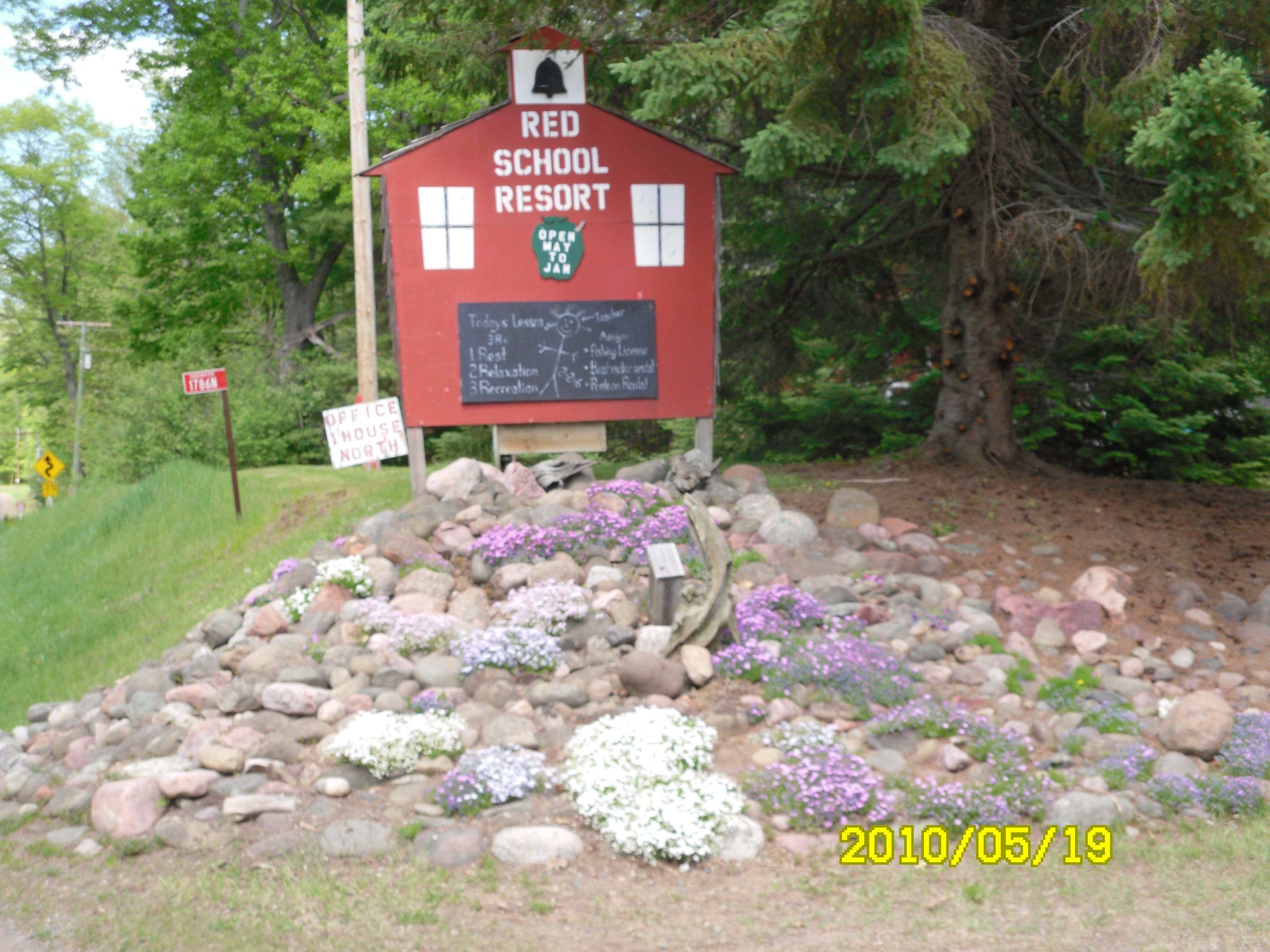 Red School Resort School sign.